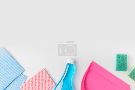 top view of colorful washing sponges, bottle and scoop, isolated on white