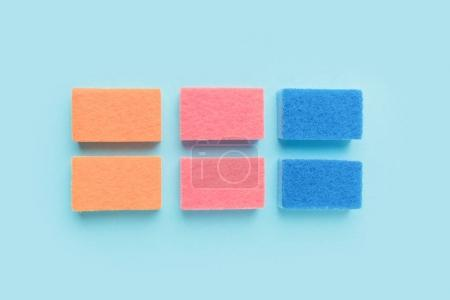 Photo for Top view of colorful washing sponges, on blue - Royalty Free Image