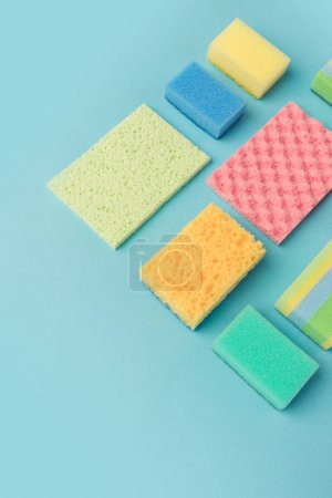 top view of colorful washing sponges, isolated on blue
