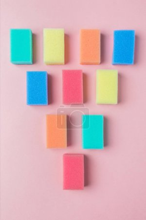 Photo for Top view of colorful washing sponges, on pink - Royalty Free Image