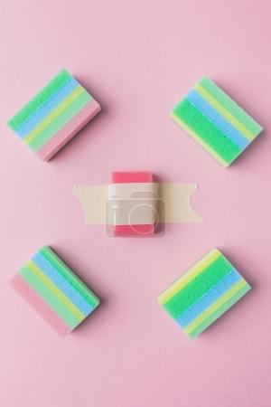 top view of colorful washing sponges, isolated on pink