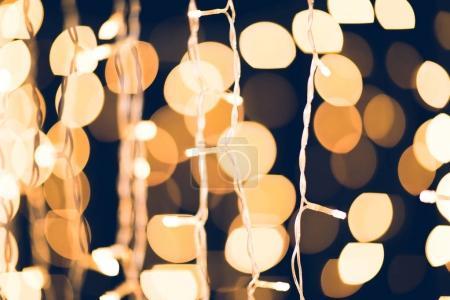 beautiful holiday garland on dark background