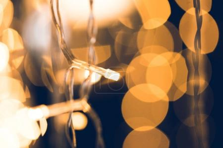 Photo for Close-up shot of beautiful golden garland on black background - Royalty Free Image