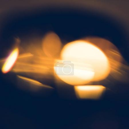 Photo for Blurred abstract golden fugures on black background - Royalty Free Image