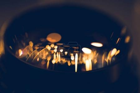 close-up shot of garland lights reflecting in camera lens