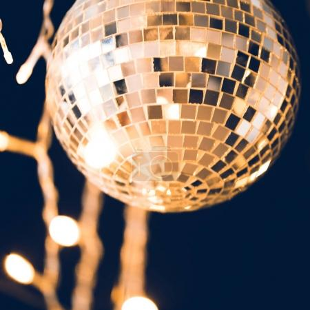 Photo for Close-up shot of glossy disco ball with garland - Royalty Free Image