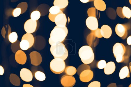 beautiful round golden bokeh on black background