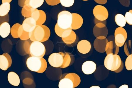 golden round bokeh on black background