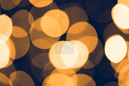 abstract golden bokeh on black background