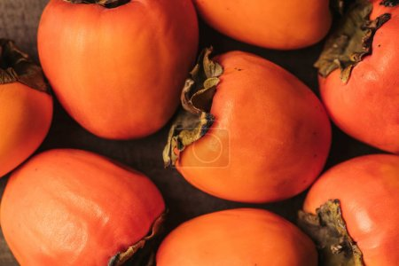 top view of ripe orange persimmons