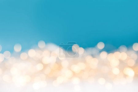 glossy christmas blurred lights on blue background