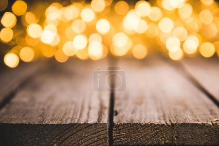 festive blurred lights on wooden surface, christmas background
