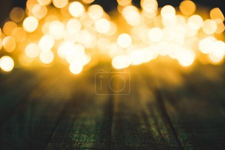 festive bokeh lights on wooden surface, christmas background