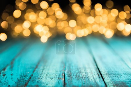 Photo for Festive bokeh lights on blue wooden surface, christmas background - Royalty Free Image