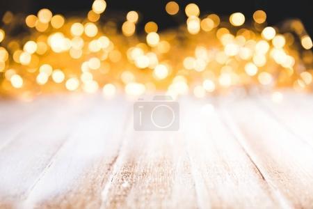 festive bokeh lights on wooden surface, christmas decor