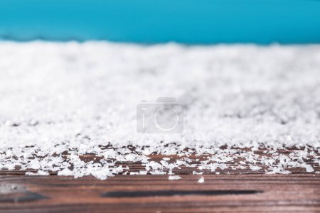 winter background with snow on wooden surface with copy space