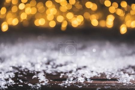 christmas background with snow and shiny blurred lights