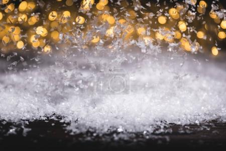 frost on window and snow with blurred lights on background