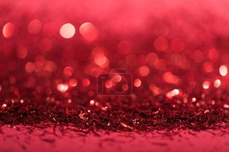 Photo for Christmas background with red shiny blurred confetti - Royalty Free Image