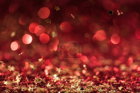 Photo for Christmas texture with falling red shiny confetti stars - Royalty Free Image