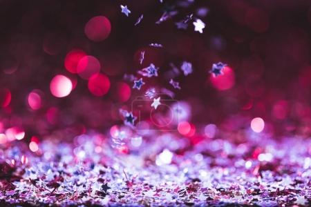 christmas texture with falling pink and silver shiny confetti stars