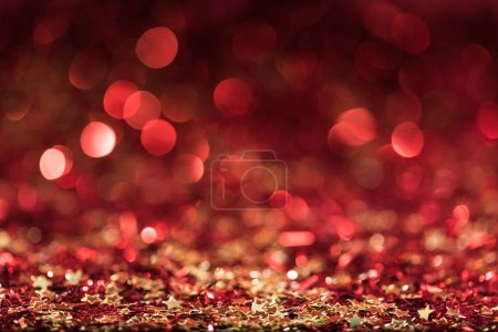 christmas background with red shiny confetti stars