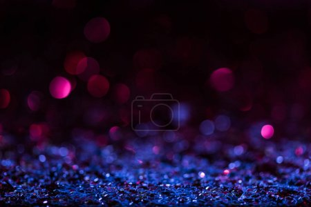 Photo for Christmas background with blue and pink blurred shiny confetti stars - Royalty Free Image