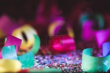 christmas confetti and shiny stars with blurred background