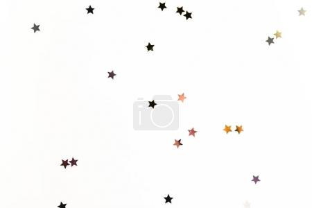 christmas golden confetti stars isolated on white background