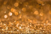 christmas background with falling golden shiny confetti stars