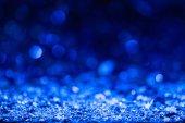 """Постер, картина, фотообои """"Новогодний фон с голубой затуманенное блестящим конфетти звёзд"""""""