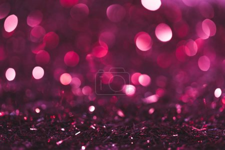 Christmas background with pink and purple shiny co...