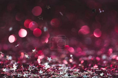 Photo for Christmas background with falling pink and purple shiny confetti stars - Royalty Free Image