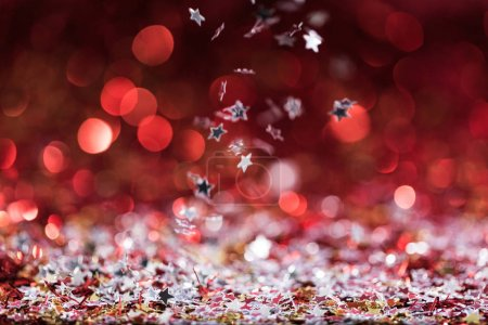 christmas background with falling red shiny confetti stars