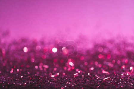 Photo for Christmas background with pink and purple shiny confetti - Royalty Free Image