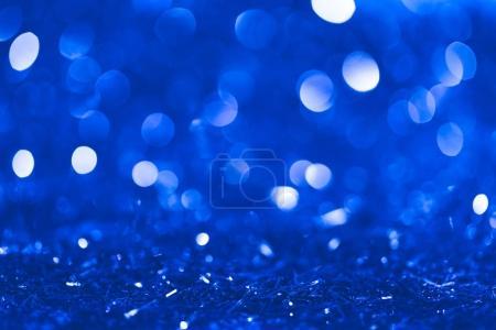 confettis flous bleus de Noël avec bokeh