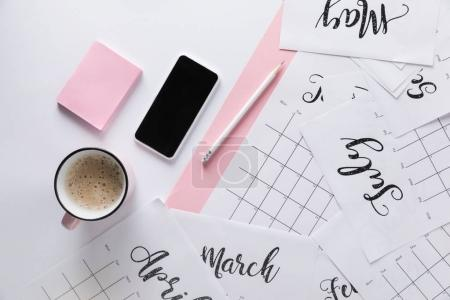 Photo for Flat lay with calendar, smartphone, cup of coffee and sticky notes isolated on white - Royalty Free Image