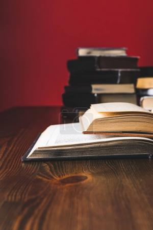 opened juridical books on wooden table, law concept