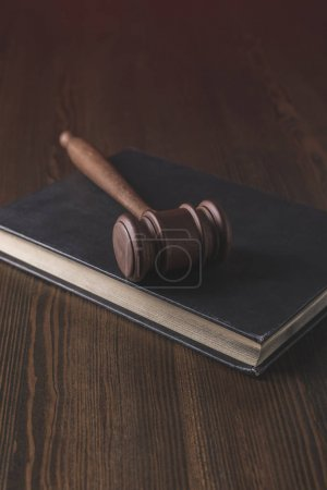 juridical book with hammer on wooden table, law concept