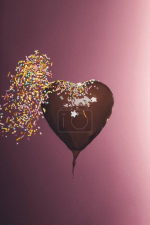 Photo for Chocolate heart shaped candy with falling glaze isolated on pink - Royalty Free Image