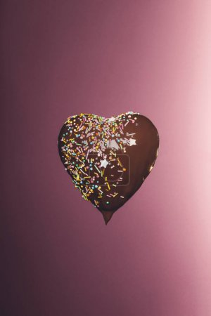 Photo for Chocolate heart shaped candy with glaze isolated on pink - Royalty Free Image