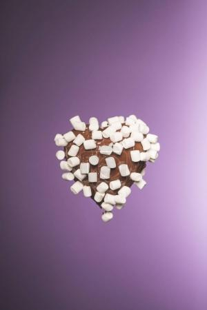 Photo for Chocolate heart shaped candy with marshmallow isolated on purple - Royalty Free Image