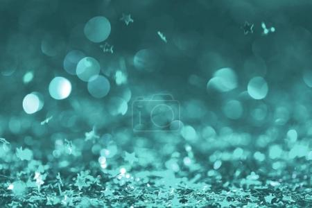 Festive background with shining confetti in turquoise tones