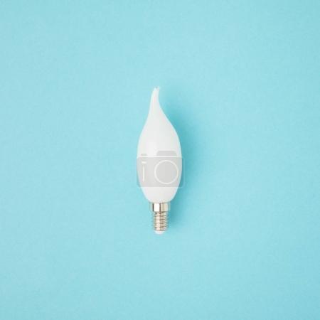close up view of white light bulb isolated on blue