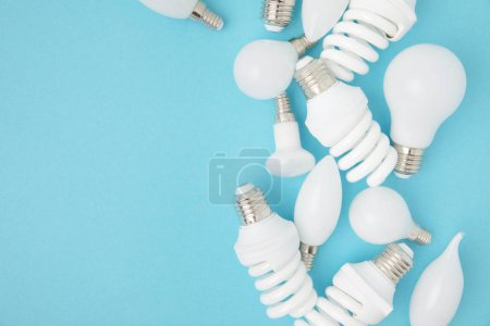 Photo for Top view of different white lamps isolated on blue - Royalty Free Image