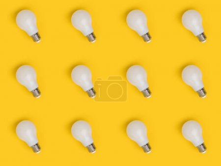 full frame of arrangement of light bulbs isolated on yellow