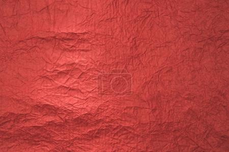 close up view of red wrapping paper texture