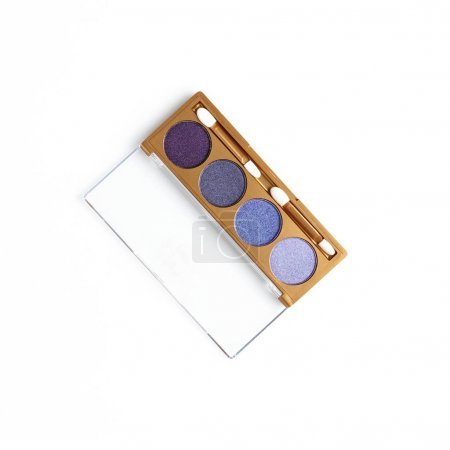 top view of opened container with different shaded purple cosmetic eye shadows isolated on white
