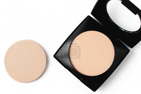 top view of compact powder and sponge isolated on white
