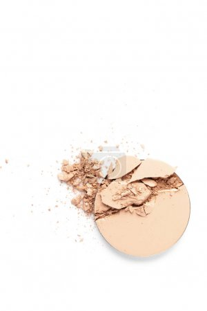 top view of cracked cosmetic powder isolated on white